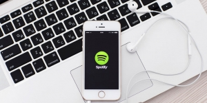 iPhone with Spotify app on iBook